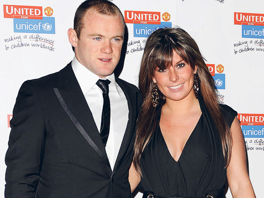 High-profile football wives in Twitter spat over story leaks