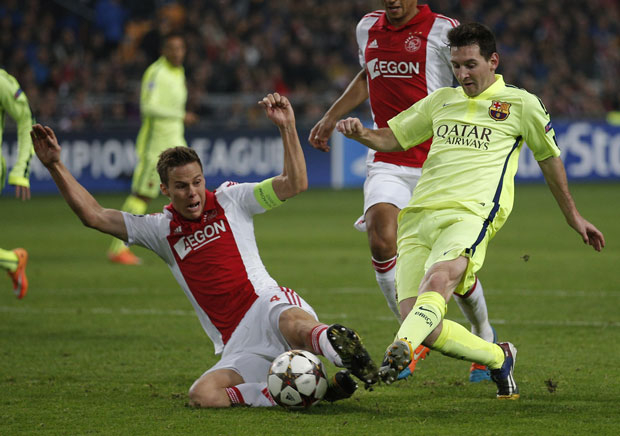 bb24c1eb1c6 1.1408895-1896410288. Barcelona's Lionel Messi is tackled by Ajax's Niklas  Moisander during the Group F Champions League ...