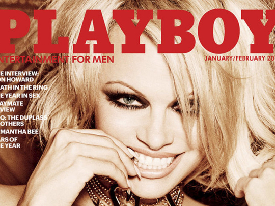 Pamela Anderson, 43, poses for 13th Playboy cover - NY