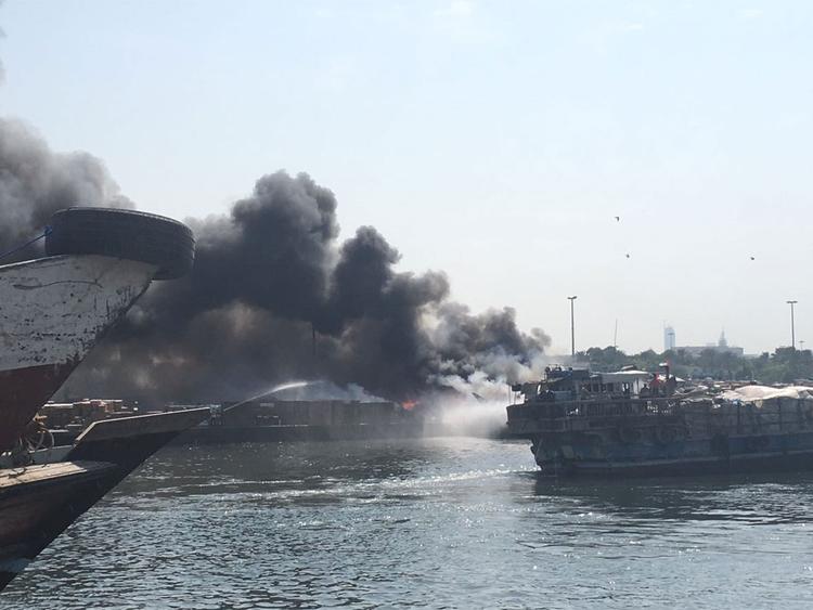 Cargo boat sinks after catching fire in Dubai Creek | Uae
