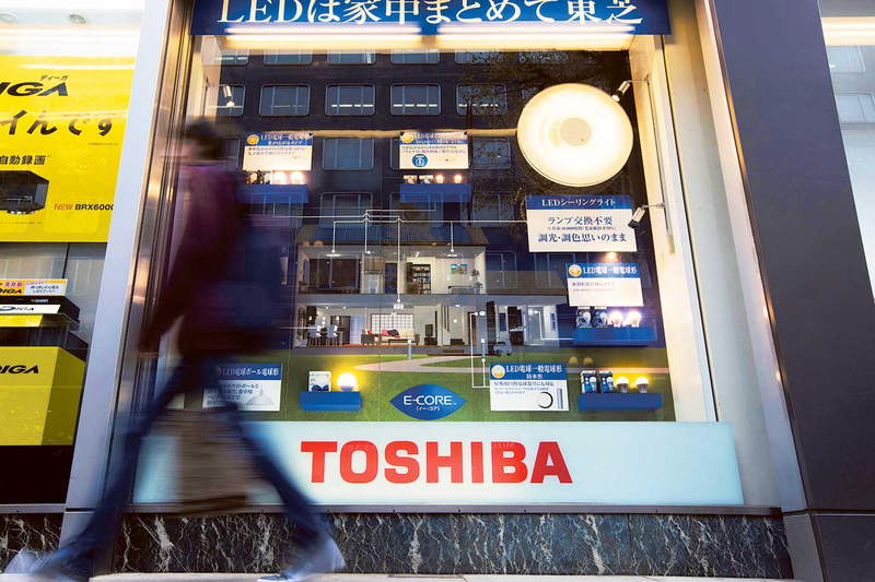 Toshiba CEO resigns as buyout offer stirs turmoil