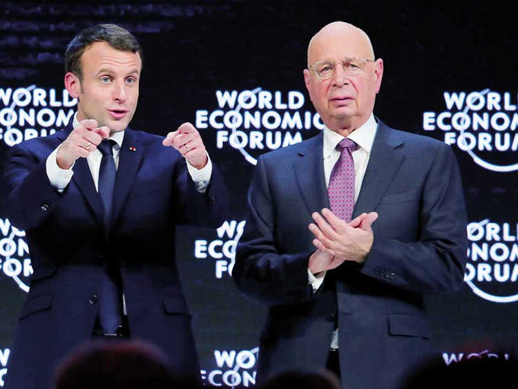 Macron tells Davos elite that they need to share the wealth | Business –  Gulf News