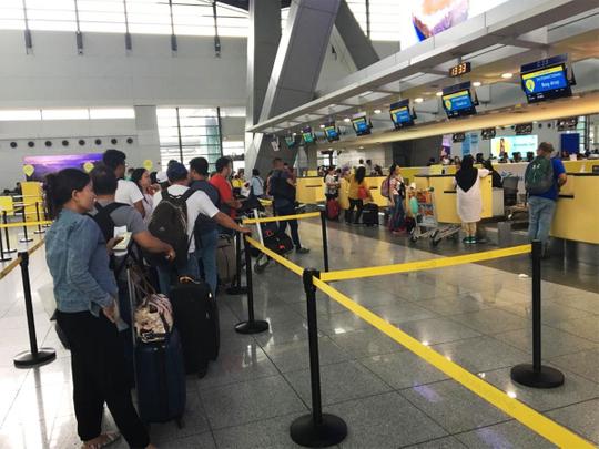 Filipinos checking in at at the Manila International Airport NAIA
