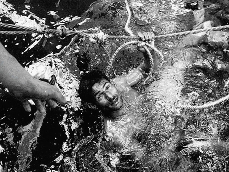 A diver resurfaces with his catch