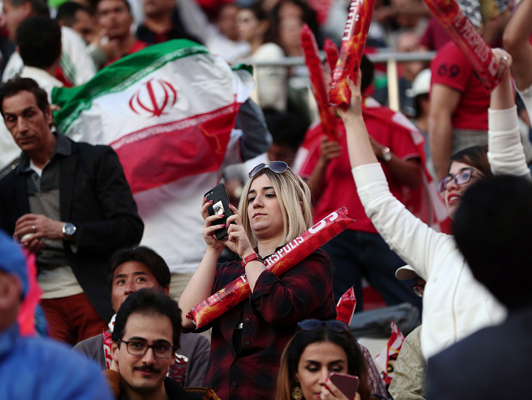 Iranian fans hold their national flag