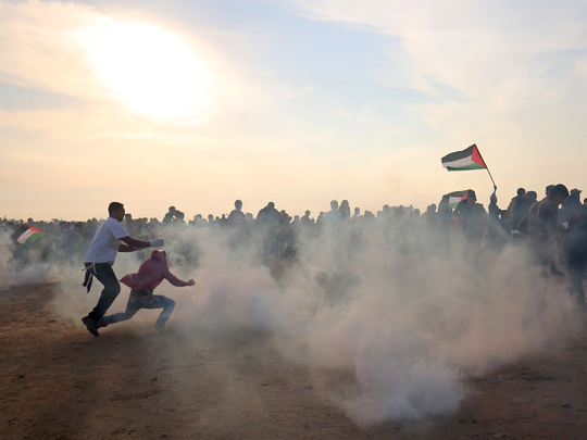 Palestinians run for cover
