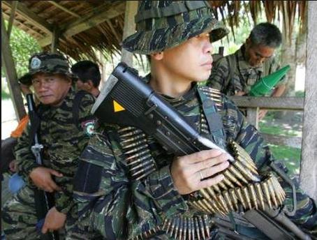 Heavily-armed members of the Moro Islamic Liberation Front (MILF) serve as security of their leader Al Haj Murad.