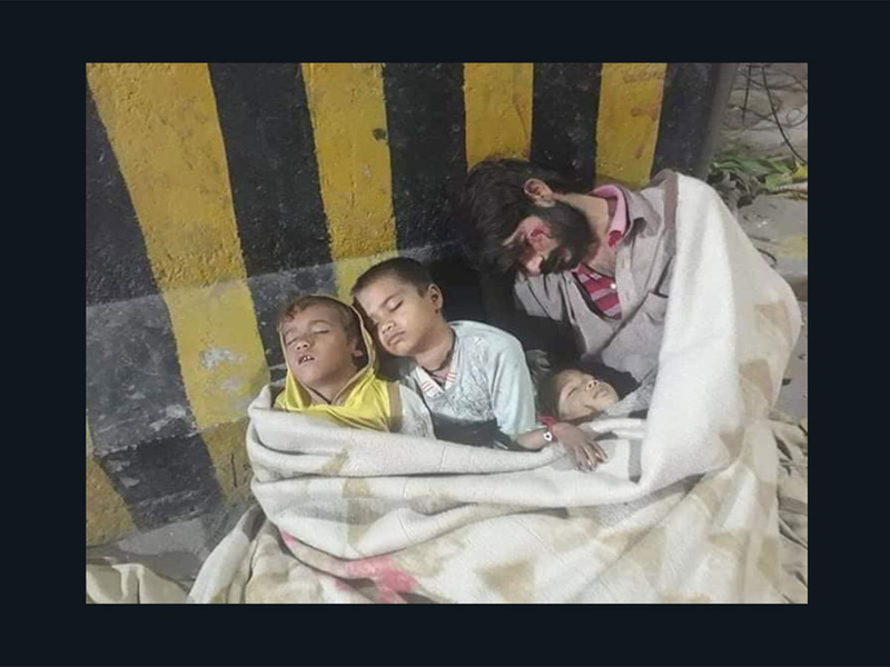 Viral picture in Pakistan of homeless man and children