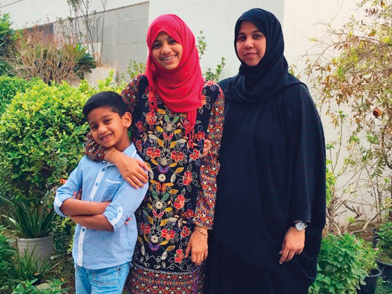 Aliya with her brother and mother Fareeda.