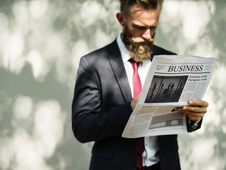Illustrative image of man reading business paper