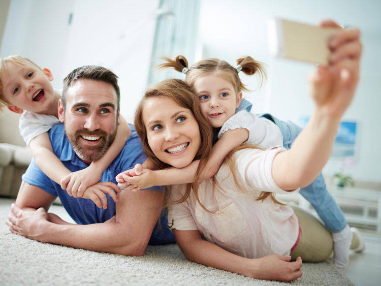 woman clicking pictures of children