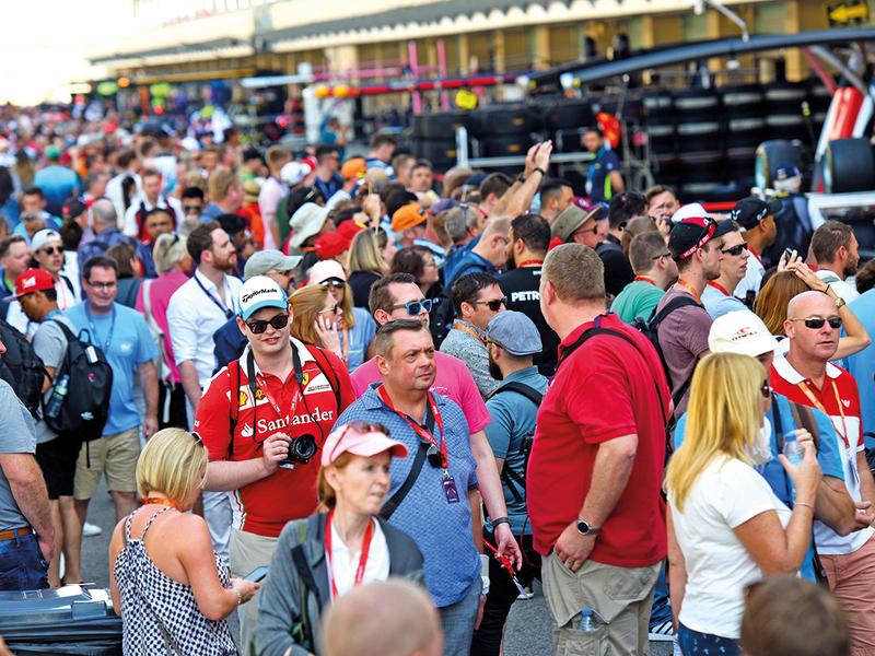 Formula 1 fans walk the pit lane