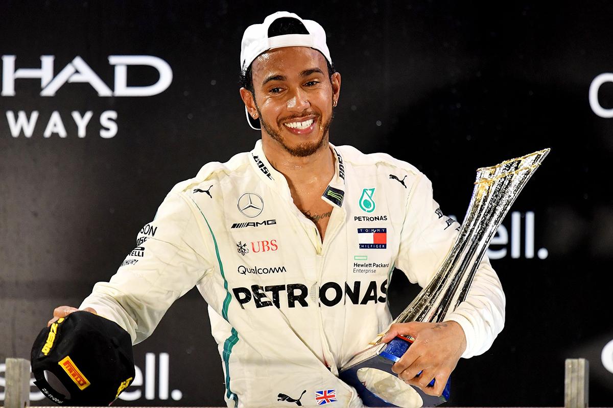 Mercedes' Lewis Hamilton celebrates on the podium