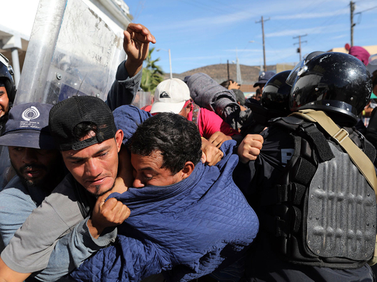 Migrants clash with Mexican police