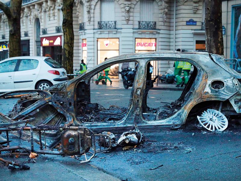 A burned car in a street