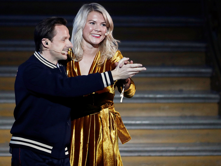 Ada Hegerberg (R) dances with French DJ and producer Martin Solveig