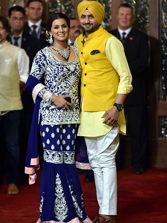 Cricketer Harbhajan Singh with wife Geeta Basra