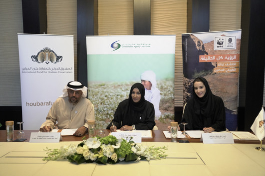 NAT_181220 Laila Abdullatif, Dr. Shaikha Al Dhaheri and Mohammed Al Baidani signing...