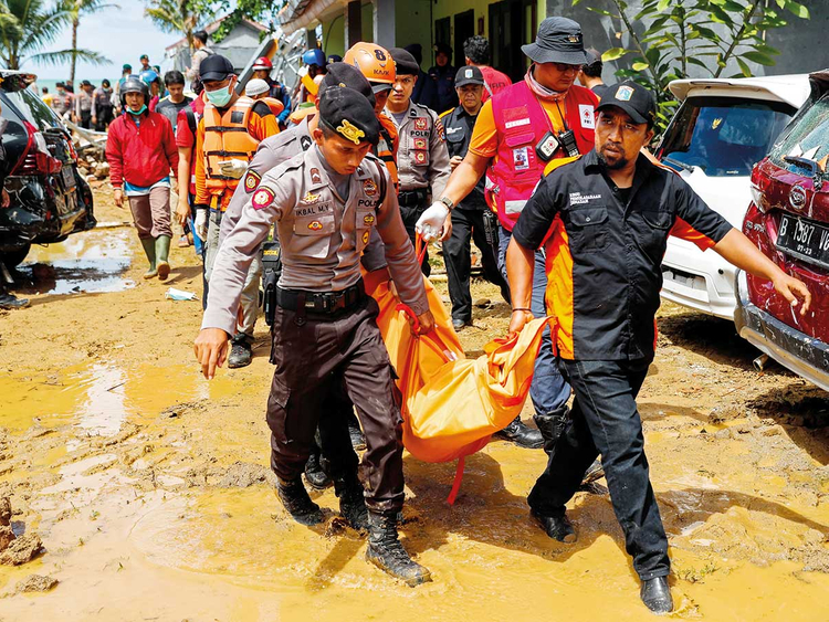 Rescue workers carry a body bag