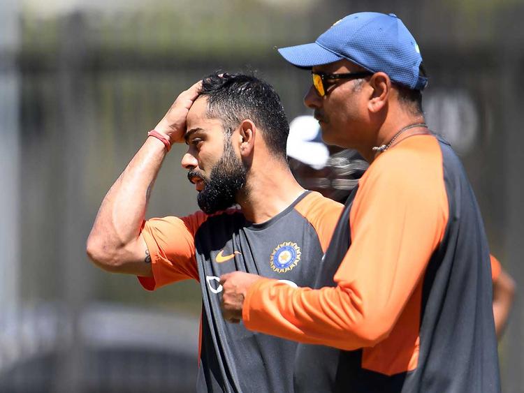 Virat Kohli (L) and coach Ravi Shastri