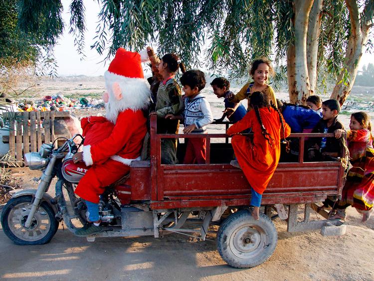 A man dressed in a Santa Claus