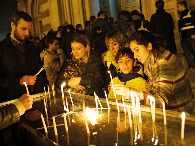 People light candles