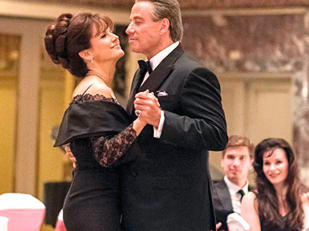 tab John Travolta and Kelly Preston in Gotti (2018).