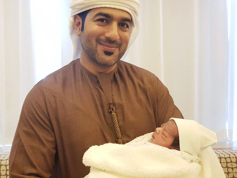 Baby Khalifa Al Marzouqi with his father.