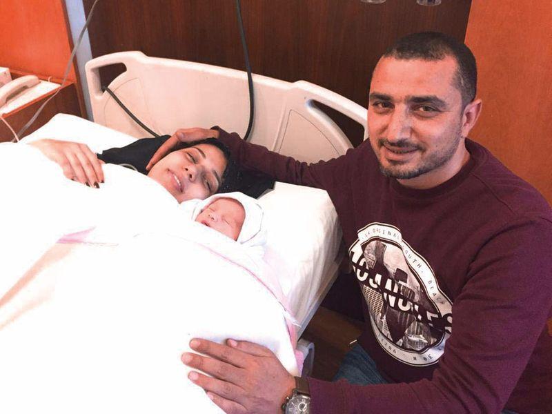 Egyptian parents Safiya Abbas Morsy and Hani Ahmed with the newborn