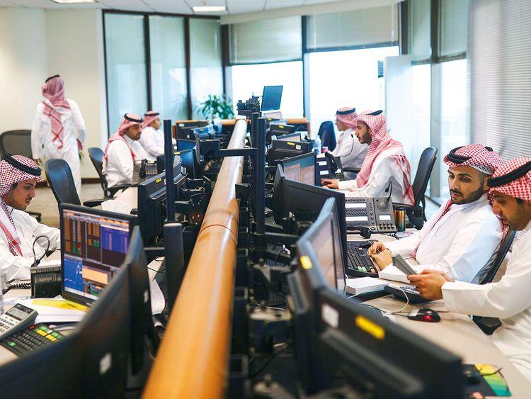Traders at Alawwal Bank in Riyadh