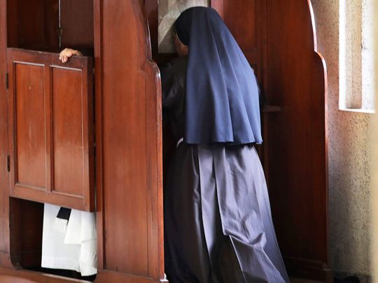 A nun partakes in the sacrament of confession