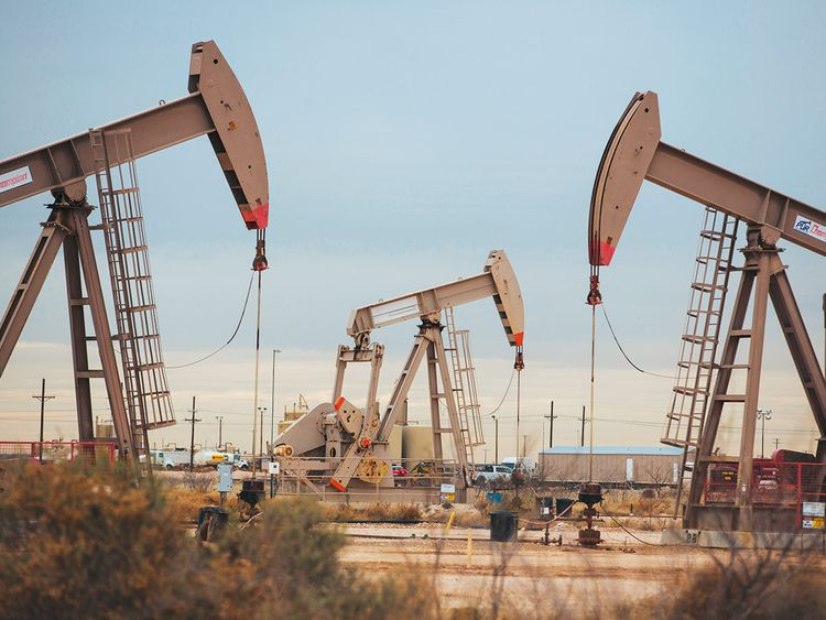 Pump jacks extract crude oil from oil wells