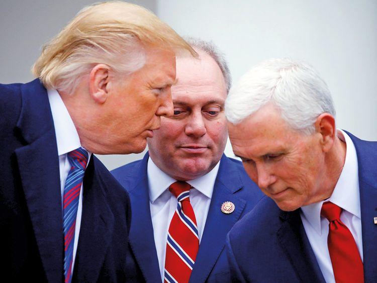 US President Donald Trump confers