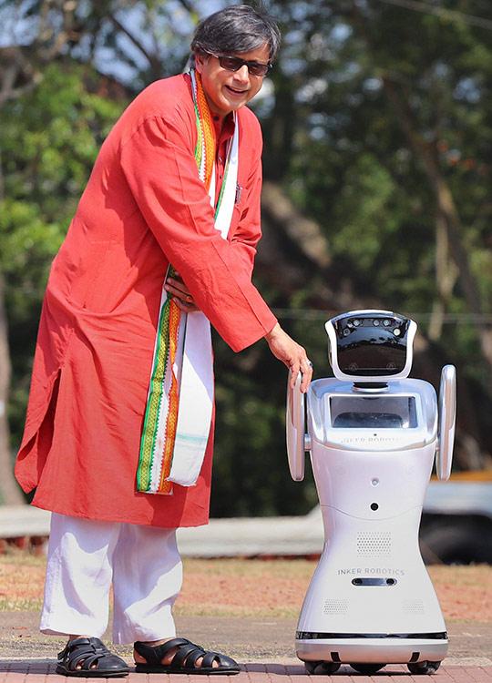 Shashi Tharoor with humanoid robot