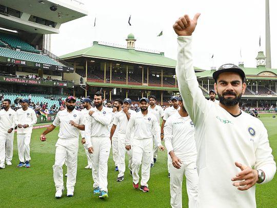 India's captain Virat Kohli (R) gestures