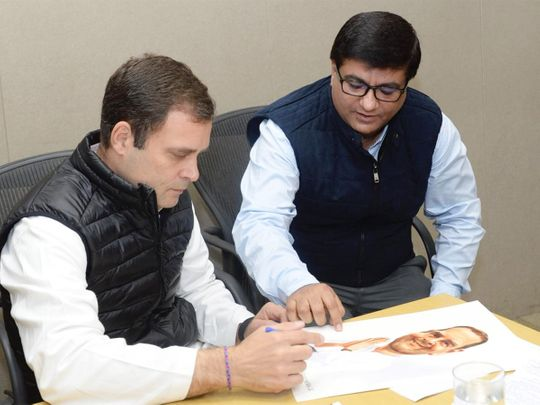 Rahul Gandhi signs an autograph