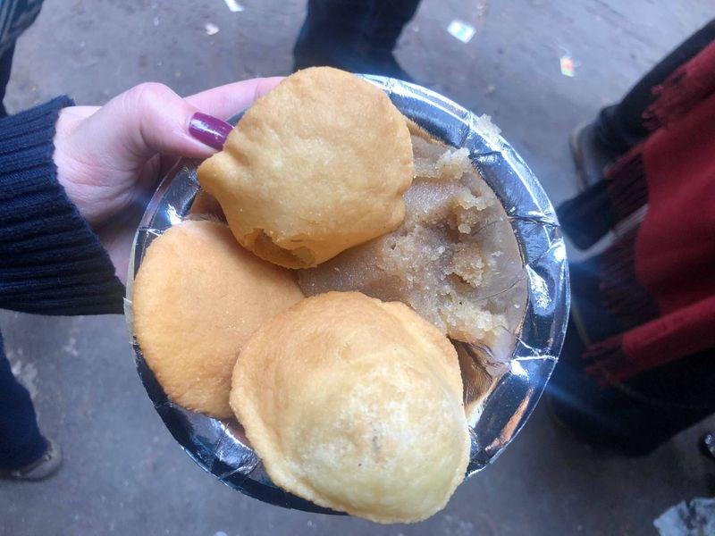 Puri and halwa, a breakfast dish.