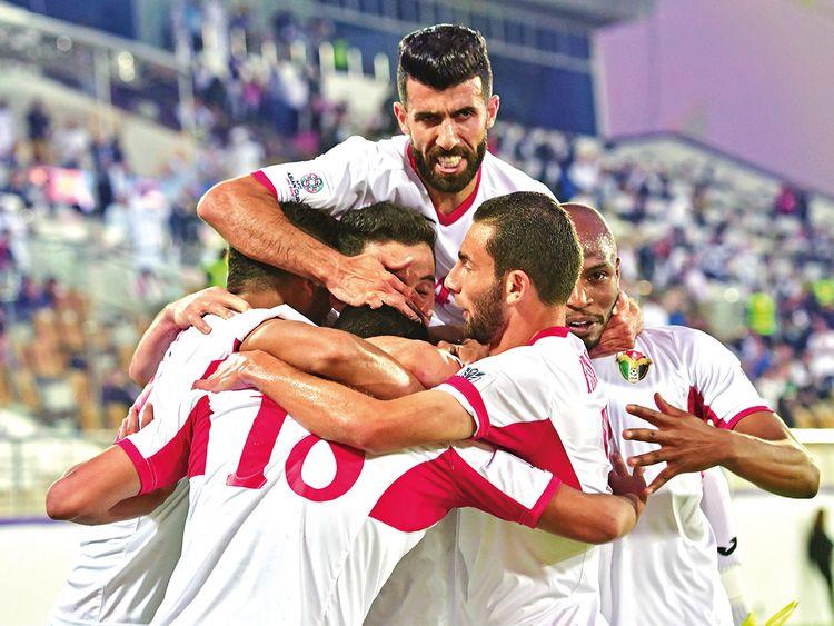 Jordan's players celebrate