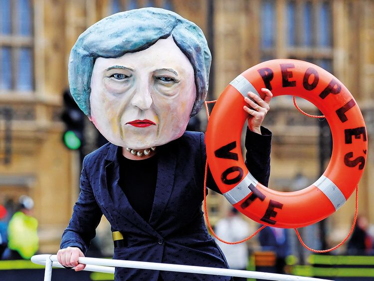A campaigner dressed as Theresa May