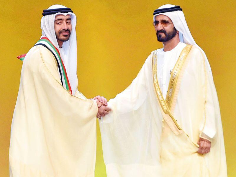 Shaikh Mohammad presents a sash to Shaikh Abdullah