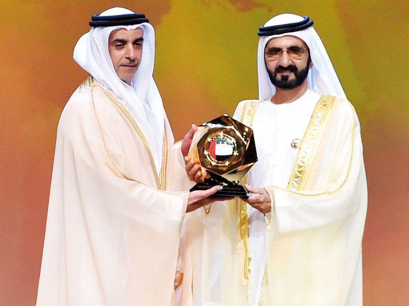 Shaikh Mohammad presents excellence award to Shaikh Saif