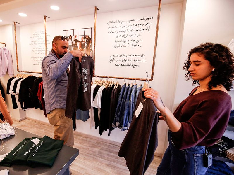 Yasmeen Mjalli arranges clothes
