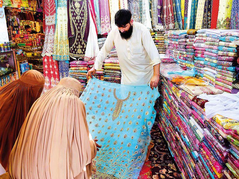Afghan refugees run hundreds of shops in Peshawar.