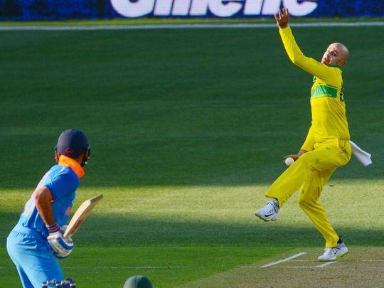 India's Virat Kohli (L) prepares to hit a delivery from Australia's Nathan Lyon