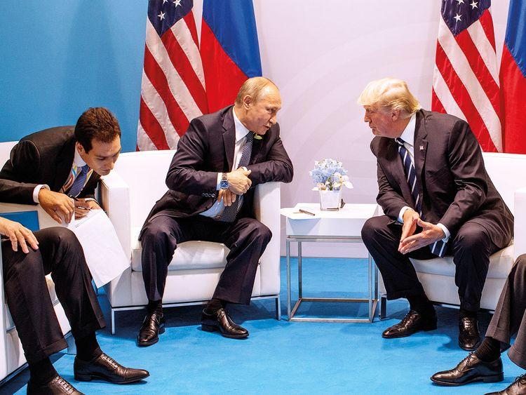 President  Donald Trump meets with Russian President Vladimir Putin