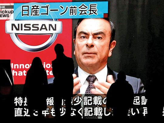 A street monitor broadcasts news about Carlos Ghosn in Tokyo