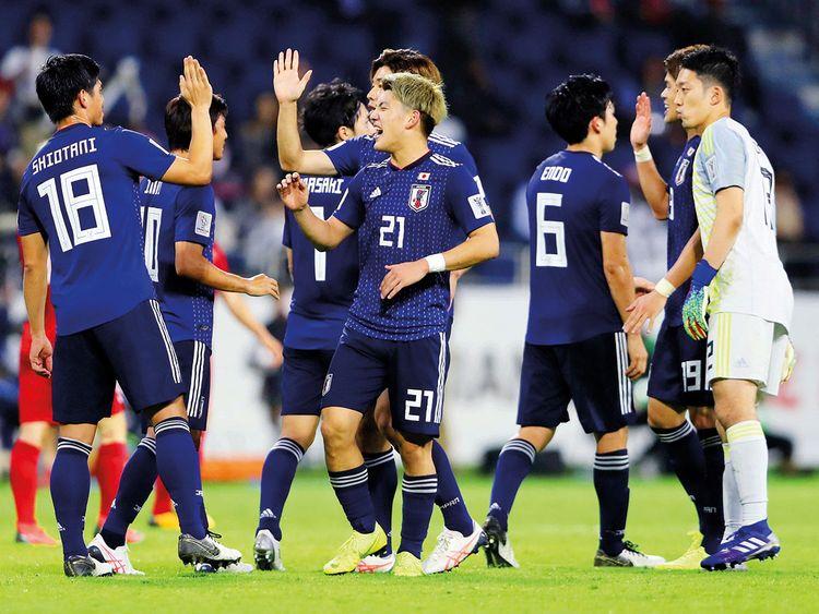 Japan's Ritsu Doan and team mates celebrate