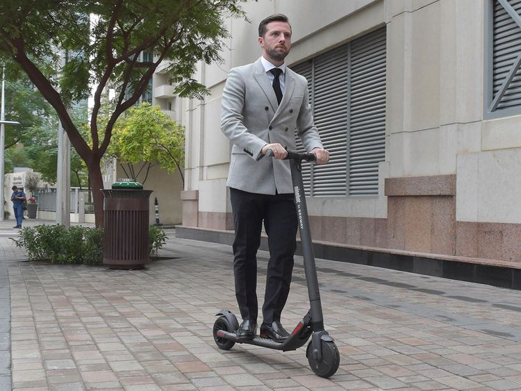 Neil Ormond with his electric scooter