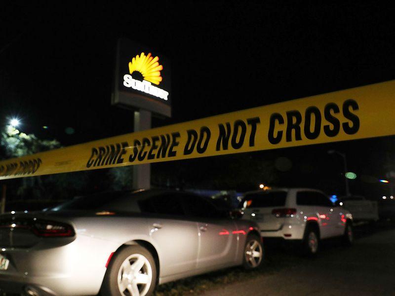 Police tape marks the scene