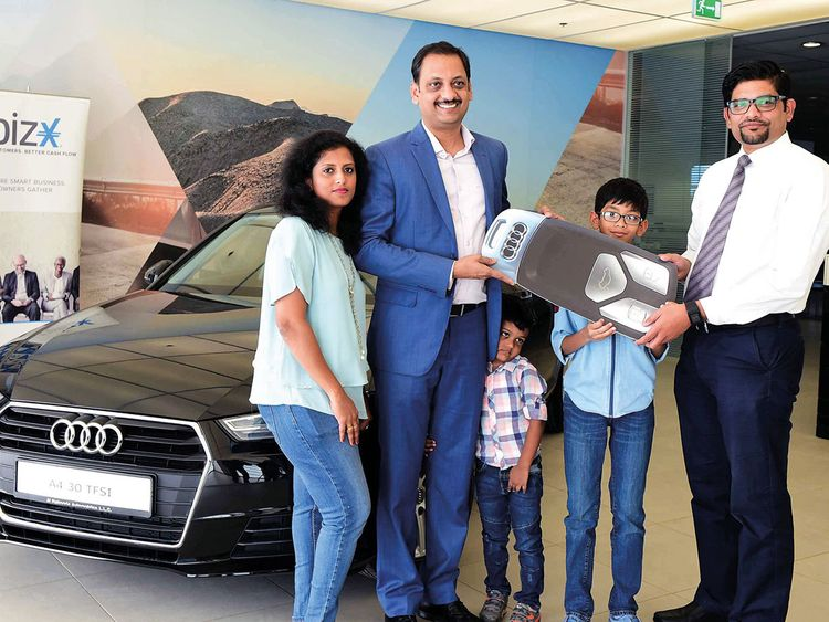 Renny Varghese is presented the Audi A4 car